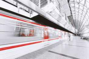 blurred motion of illuminated railroad station in city